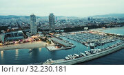 Купить «Aerial view of autumn twilight in Barcelona, Spain», видеоролик № 32230181, снято 27 сентября 2018 г. (c) Яков Филимонов / Фотобанк Лори