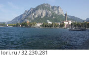 Купить «Picturesque view of small city of Lecco on shore of Lake Como on background of San Martino mountain on summer day, Italy», видеоролик № 32230281, снято 1 сентября 2019 г. (c) Яков Филимонов / Фотобанк Лори