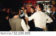 Купить «Young attractive women with cocktails having fun with workmates on office party at nightclub», видеоролик № 32230309, снято 12 апреля 2019 г. (c) Яков Филимонов / Фотобанк Лори