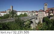 Купить «Scenic view of ancient arched bridge Ponte del Diavolo across Natisone river in small Italian town of Cividale del Friuli», видеоролик № 32231505, снято 3 сентября 2019 г. (c) Яков Филимонов / Фотобанк Лори