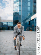 One businessman poses on bicycle in downtown. Стоковое фото, фотограф Tryapitsyn Sergiy / Фотобанк Лори