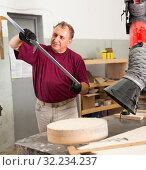 Купить «Worker performs measurements on wooden workpiece with caliper. Working with the measuring tool», фото № 32234237, снято 20 октября 2019 г. (c) Яков Филимонов / Фотобанк Лори