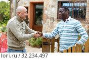Купить «Good neighbors talk on the border of their farms», фото № 32234497, снято 15 декабря 2018 г. (c) Яков Филимонов / Фотобанк Лори