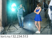 Купить «Photographer taking pictures of pretty woman», фото № 32234513, снято 5 октября 2018 г. (c) Яков Филимонов / Фотобанк Лори