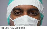Купить «face of doctor or surgeon in protective mask», видеоролик № 32234653, снято 12 сентября 2019 г. (c) Syda Productions / Фотобанк Лори