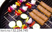 Купить «barbecue kebab meat and vegetables on grill», видеоролик № 32234745, снято 20 сентября 2019 г. (c) Syda Productions / Фотобанк Лори