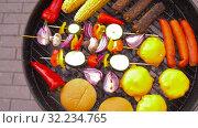 Купить «barbecue kebab meat and vegetables on grill», видеоролик № 32234765, снято 20 сентября 2019 г. (c) Syda Productions / Фотобанк Лори