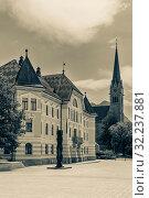 Vaduz Liechtenstein - August 05 2019: Old building parliament of Liechtenstein and Cathedral of St. Florin in Vaduz Liechtenstein. Редакционное фото, фотограф Григорий Стоякин / Фотобанк Лори