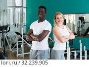 Купить «Couple posing at sport club», фото № 32239905, снято 25 февраля 2019 г. (c) Яков Филимонов / Фотобанк Лори