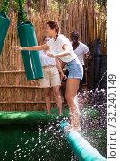 Купить «Friends are looking for adventure in an amusement park», фото № 32240149, снято 21 января 2020 г. (c) Яков Филимонов / Фотобанк Лори