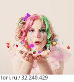 Купить «clown girl blows confetti from hands», фото № 32240429, снято 24 сентября 2019 г. (c) Майя Крученкова / Фотобанк Лори