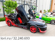 Купить «Tuned Russian automobile Lada at the city street», фото № 32240693, снято 19 мая 2018 г. (c) FotograFF / Фотобанк Лори