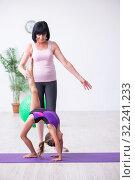 Купить «Girl and mother exercising at home», фото № 32241233, снято 16 июля 2019 г. (c) Elnur / Фотобанк Лори