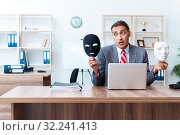 Купить «Businessman wearing mask in hypocrisy concept», фото № 32241413, снято 24 июня 2019 г. (c) Elnur / Фотобанк Лори