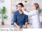 Купить «Young patient visiting doctor in hospital», фото № 32242085, снято 8 апреля 2019 г. (c) Elnur / Фотобанк Лори