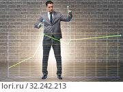 Купить «Businessman controlling the market with strings», фото № 32242213, снято 5 декабря 2019 г. (c) Elnur / Фотобанк Лори