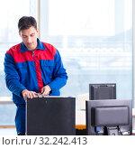 Купить «Computer repairman specialist repairing computer desktop», фото № 32242413, снято 19 января 2018 г. (c) Elnur / Фотобанк Лори