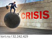 Купить «Businessman in crisis management concept», фото № 32242429, снято 20 февраля 2020 г. (c) Elnur / Фотобанк Лори