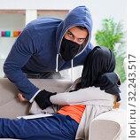 Купить «Armed man assaulting young woman at home», фото № 32243517, снято 15 декабря 2017 г. (c) Elnur / Фотобанк Лори