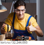 Купить «Worker working in repair workshop in woodworking concept», фото № 32244093, снято 11 августа 2017 г. (c) Elnur / Фотобанк Лори