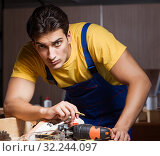 Купить «The worker working in repair workshop in woodworking concept», фото № 32244097, снято 11 августа 2017 г. (c) Elnur / Фотобанк Лори