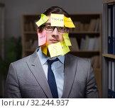 Купить «Businessman struggling with conflicting priorities during long h», фото № 32244937, снято 25 января 2017 г. (c) Elnur / Фотобанк Лори