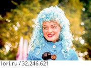 Russia, Samara, 2016: Portrait of a clowness at a flower festival. Samara. Редакционное фото, фотограф Акиньшин Владимир / Фотобанк Лори