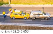 Купить «??????, ??????, 2016: Accident. Collision of two cars on the city street. Text in Russian: Yandex Taxi», фото № 32246653, снято 28 июля 2016 г. (c) Акиньшин Владимир / Фотобанк Лори