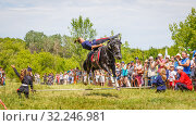 """Купить «Russia, Samara, June 2016: a demonstration of a Cossack girl on horseback for guests and spectators of the """"Journey to the Past"""" festival, which is taking place near Samarah on Sunny Summer Day.», фото № 32246981, снято 18 июня 2016 г. (c) Акиньшин Владимир / Фотобанк Лори"""