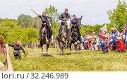 Купить «Russia, Samara, July 2016: Cossack and Cossacks on horseback jump over the barrier», фото № 32246989, снято 18 июня 2016 г. (c) Акиньшин Владимир / Фотобанк Лори