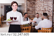 Smiling woman waitress carrying order for visitors. Стоковое фото, фотограф Яков Филимонов / Фотобанк Лори