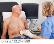 Купить «Doctor using ultrasound scan examining patient in hospital», фото № 32247889, снято 7 мая 2019 г. (c) Яков Филимонов / Фотобанк Лори