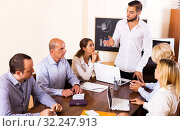 Купить «Boss and stressed co-workers», фото № 32247913, снято 24 октября 2019 г. (c) Яков Филимонов / Фотобанк Лори