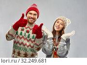 Купить «happy couple at christmas ugly sweater party», фото № 32249681, снято 9 декабря 2018 г. (c) Syda Productions / Фотобанк Лори