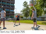 Купить «group of male friends playing street basketball», фото № 32249705, снято 21 июля 2019 г. (c) Syda Productions / Фотобанк Лори