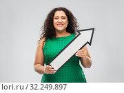 Купить «happy woman with arrow showing north east», фото № 32249897, снято 15 сентября 2019 г. (c) Syda Productions / Фотобанк Лори