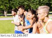 Купить «sportsmen with badge numbers on start of race», фото № 32249997, снято 16 августа 2015 г. (c) Syda Productions / Фотобанк Лори