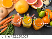 Купить «mason jar glasses of vegetable juices on table», фото № 32250005, снято 5 апреля 2018 г. (c) Syda Productions / Фотобанк Лори