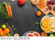 Купить «different vegetables and fruits on on slate table», фото № 32250013, снято 5 апреля 2018 г. (c) Syda Productions / Фотобанк Лори