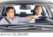 car driving school instructor teaching male driver. Стоковое фото, фотограф Syda Productions / Фотобанк Лори