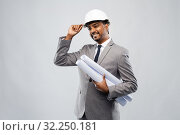 Купить «indian male architect in helmet with blueprints», фото № 32250181, снято 8 сентября 2019 г. (c) Syda Productions / Фотобанк Лори