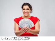 Купить «happy woman holding hundreds of money banknotes», фото № 32250229, снято 15 сентября 2019 г. (c) Syda Productions / Фотобанк Лори
