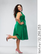 Купить «happy woman in green dress over grey background», фото № 32250253, снято 15 сентября 2019 г. (c) Syda Productions / Фотобанк Лори