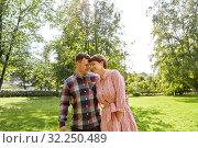 Купить «happy couple in summer park», фото № 32250489, снято 18 августа 2019 г. (c) Syda Productions / Фотобанк Лори