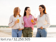 Купить «young women with non alcoholic drinks talking», фото № 32250505, снято 31 августа 2019 г. (c) Syda Productions / Фотобанк Лори