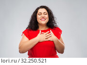 Купить «happy woman holding hands on chest or heart», фото № 32250521, снято 15 сентября 2019 г. (c) Syda Productions / Фотобанк Лори