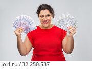 Купить «happy woman holding hundreds of money banknotes», фото № 32250537, снято 15 сентября 2019 г. (c) Syda Productions / Фотобанк Лори