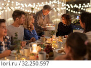 Купить «happy family having birthday party at home», фото № 32250597, снято 15 декабря 2018 г. (c) Syda Productions / Фотобанк Лори
