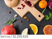Купить «different vegetables and fruits on on slate table», фото № 32250629, снято 5 апреля 2018 г. (c) Syda Productions / Фотобанк Лори