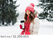 Купить «young woman with hot drink in tumbler in winter», фото № 32250653, снято 29 января 2019 г. (c) Syda Productions / Фотобанк Лори